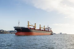 Cargo ships in river being tugged Royalty Free Stock Photos