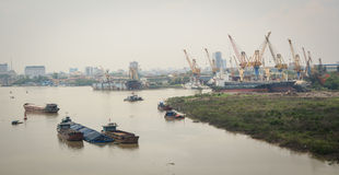 Cargo ships on the river in Haiphong, Vietnam.  Stock Photo