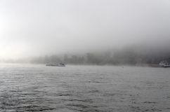 Cargo ships on River Rhine. Cargo ships in the river Rhine on a foggy day Stock Photo