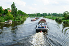 Cargo ships on a river Royalty Free Stock Photography