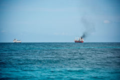 Cargo ships sailing in the Indian ocean Royalty Free Stock Photography