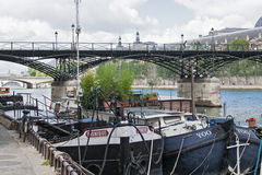 cargo ships on seine river near the pont des arts Royalty Free Stock Photography