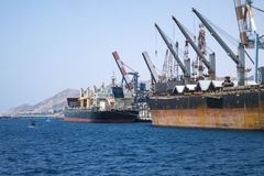 Cargo ships stand in the port. Of Eilat on the Red Sea Israel Royalty Free Stock Photography