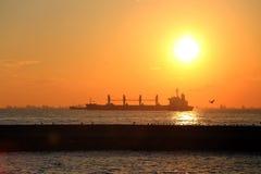 Cargo ships at sunset Stock Photos