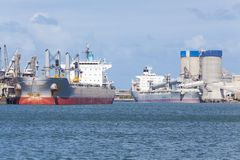 Cargo ships unloading at a port Royalty Free Stock Photography