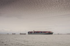 Cargo Ships Wait to be Unloaded in Long Beach California Royalty Free Stock Photos