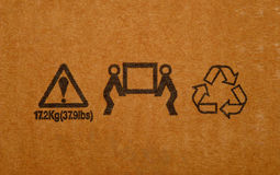 Cargo signs. Background texture of brown cardboard with standard cargo signs Stock Photo
