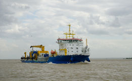 Cargo specialized ship. Sailing in storm water Stock Image