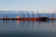 Cargo terminal. Cargo ship in port. Royalty Free Stock Photo