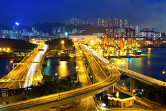 Cargo terminal traffic in city at night Royalty Free Stock Photos