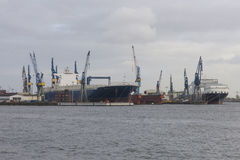 Cargo traffic in Hamburg. It`s the central hub for trade with Ea. Transhipment cranes in Hamburg Sea Port. The Port of Hamburg is a sea port on the river Elbe in Stock Photos