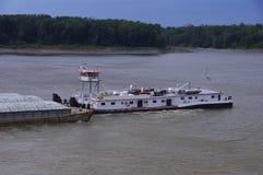 Tug boat pushing barge traffic on river stock photos
