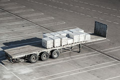 Cargo trailer stands on the parking of terminal Stock Image