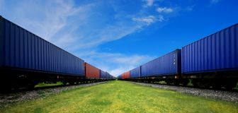 Cargo train. Train of red and blue shipping containers stock images