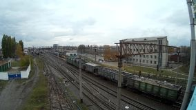 Cargo train arrives at railway station high view. Ukrain Khmelnytskyi stock video