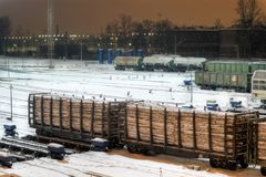 Cargo train carrying wood at night. Cargo train carrying wood at winter night Royalty Free Stock Photos