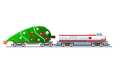 Cargo train with christmas tree. Modern cargo train with decorated christmas tree on platform Stock Photo