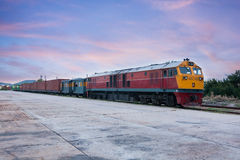Cargo train and container at twilight Stock Image
