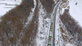 Cargo train delivering goods, fuel, petrolium in winter. Aerial. 4K. stock video