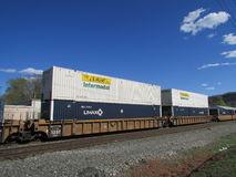 Cargo train of inter modal containers of JB Hunt and Umax in West Haverstraw, NY. Stock Photos