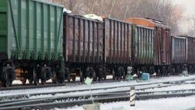 Cargo train move on snow rail road in winter russia. Cargo train move on snow rail road in russia stock video
