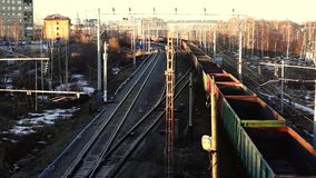 Cargo train moves on railway. To railway station in spring evening stock video