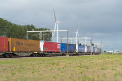 Cargo train passing by Royalty Free Stock Photos