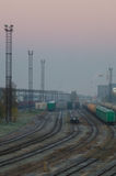 Cargo train platform with containers on early misty morning Stock Images