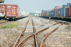 Cargo train platform with freight train container at depot.  Royalty Free Stock Photography