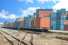 Cargo train platform with freight train container at depot Stock Photos