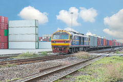 Cargo train platform with freight train container at depot Royalty Free Stock Image