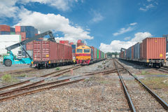 Cargo train platform with freight train container at depot Stock Photography