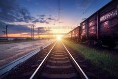 Cargo train platform at sunset. Railroad in Ukraine. Railway sta Royalty Free Stock Photo