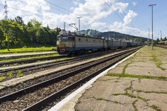 Cargo train in rail station Royalty Free Stock Photography