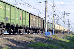 The cargo train on rails in the summer afternoon. Royalty Free Stock Images