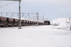 Cargo train in the snow Stock Image