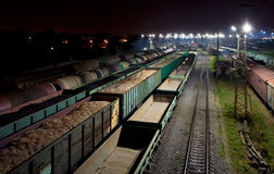 Cargo train station at night. Trains shipping coal, grain, sawdust (splint) and fuel oil Royalty Free Stock Photography