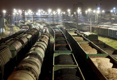 Cargo train station at night. Trains shipping coal, grain and fuel oil Stock Images