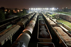 Cargo train station at night. Trains shipping coal, grain and fuel oil Royalty Free Stock Photography