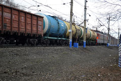 The cargo train with tanks moves on railway tracks. Stock Image