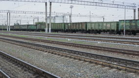 Cargo train traveling on railway tracks stock video footage