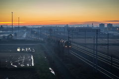 Cargo train at twilight Royalty Free Stock Photo