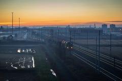 Cargo train at twilight Royalty Free Stock Photo
