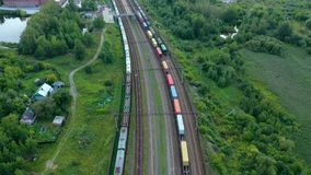 Cargo trains. Aerial view of colorful freight trains. Railway station. Wagons with goods on railroad. Heavy industry