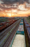 Cargo trains in HDR. Trains shipping coal, splint and macadam at sunset Royalty Free Stock Images