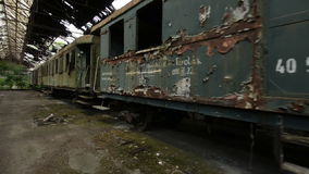 Cargo trains in old train depot glidecam footage stock video