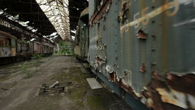 Cargo trains in old train depot glidecam footage stock video footage