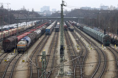 Cargo trains. Railway trains on railroad transporting, cars, oil and containers stock images