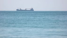 Cargo transportation by sea. Large loaded barge. Nice view of the sea stock footage