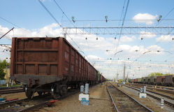 Cargo transportations. Freight train on rails Stock Photo
